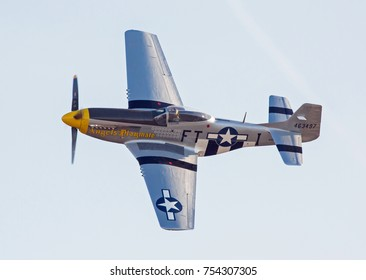 MONROE, NC - NOVEMBER 11, 2017:  A P-51 Mustang fighter aircraft performing during the Warbirds Over Monroe Air Show in Monroe, NC.