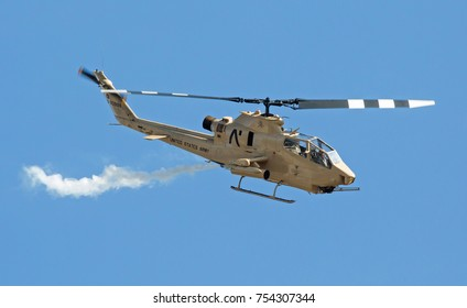 MONROE, NC - NOVEMBER 11, 2017:  An AH-1F Cobra attack helicopter performing at the Warbirds Over Monroe Air Show in Monroe, NC.