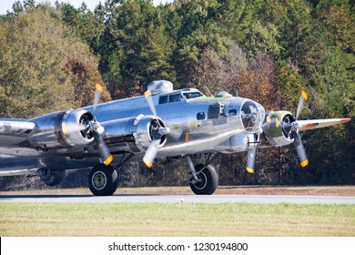 MONROE, NC (USA) - November 10, 2018: A B-17 bomber revs its engines on the runway at the Warbirds Over Monroe Air Show.