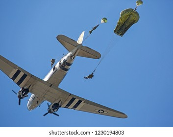 MONROE, NC (USA) - November 10, 2018: Paratroopers jump from a C-47 aircraft during a demonstration at the Warbirds Over Monroe Air Show.