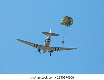 MONROE, NC (USA) - November 10, 2018: An army paratrooper jumps from a C-47 cargo aircraft during a demonstration at the Warbirds Over Monroe Air Show.