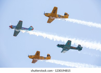 MONROE, NC (USA) - November 10, 2018: Four aerobatic aircraft flying in formation at the Warbirds Over Monroe Air Show.