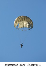 MONROE, NC (USA) - November 10, 2018:  An army paratrooper floats to the ground during a demonstration at the Warbirds Over Monroe Air Show.
