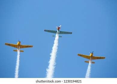 MONROE, NC (USA) - November 10, 2018: Three aerobatic aircraft flying in formation at the Warbirds Over Monroe Air Show.