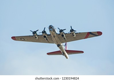 """MONROE, NC (USA) - November 10, 2018: A B-17 """"Flying Fortress"""" in flight against a clear blue sky at the Warbirds Over Monroe Air Show."""