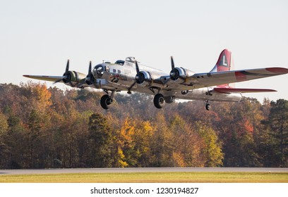 """MONROE, NC (USA) - November 10, 2018: A B-17 """"Flying Fortress"""" takes off from a runway at the Warbirds Over Monroe Air Show."""