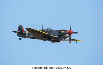 MONROE, NC (USA) - November 10, 2018:  A British Spitfire fighter aircraft in flight against a bright blue sky at the Warbirds Over Monroe Air Show.