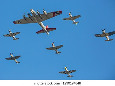 MONROE, NC (USA) - November 10, 2018: World War II aircraft fly in formation against a deep blue sky at the Warbirds Over Monroe Air Show.