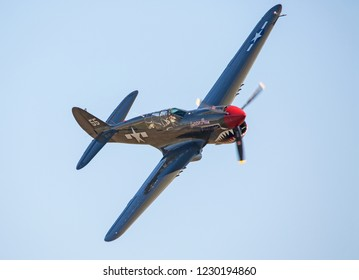 MONROE, NC (USA) - November 10, 2018: A P-40 Warhawk fighter aircraft in flight during the Warbirds Over Monroe Air Show.