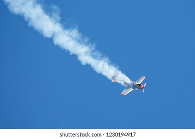 MONROE, NC (USA) - November 10, 2018: An aerobatic aircraft performs a dive in deep blue sky at the Warbirds Over Monroe Air Show.