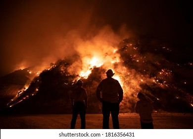Monrovia, California / USA - September 15, 2020: Firefighters work the Bobcat Wildfire in the hills above Los Angeles.
