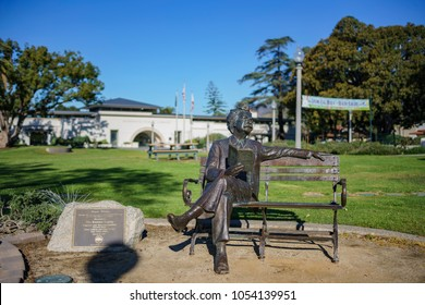 Monrovia, MAR 19: Exterior view of the Monrovia Library and Mark Twain statue on MAR 19, 2018 at Los Angeles County, California