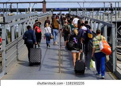 Mons, Belgium Sep. 16, 2018. Passengers walk on a platform after a commuter train arrived at Central railway station.