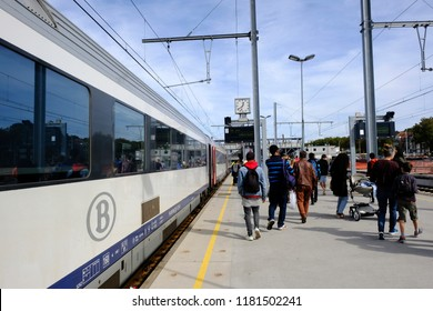 Mons, Belgium Sep. 16, 2018. Passengers walk on a platform after a commuter train arrived at Central railway station.