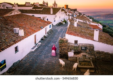 Monsaraz. Stunning sunrise photo of Monsaraz village in Alentejo region, Portugal. A Castle and white houses village on top of the mountain.