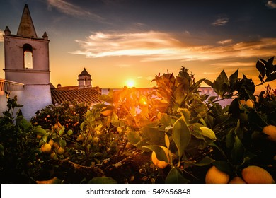 Monsaraz. Stunning sunset photo of Monsaraz village in Alentejo region, Portugal. A Castle and white houses village on top of the mountain.
