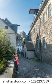 MONSCHAU, AACHEN, GERMANY, OCTOBER 2018 - Tourists taking photos in the historic town of Monschau, Aachen, Germany