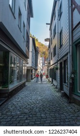 MONSCHAU, AACHEN, GERMANY, OCTOBER 2018 - Tourists walking the narrow cobbled street in the historic center of Monschau, Aachen, Germany