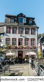 MONSCHAU, AACHEN, GERMANY, OCTOBER 2018 - Picturesque cafe bar in the historic center of Monschau, Aachen, Germany