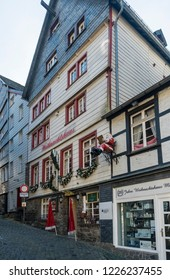 MONSCHAU, AACHEN, GERMANY, OCTOBER 2018 - Picturesque timber framed Christmas shop in the historic center of Monschau, Aachen, Germany