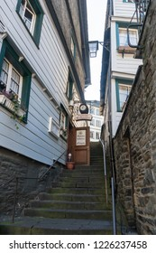 MONSCHAU, AACHEN, GERMANY, OCTOBER 2018 - Picturesque buildings and narrow steep stepped alley in the historic center of Monschau, Aachen, Germany