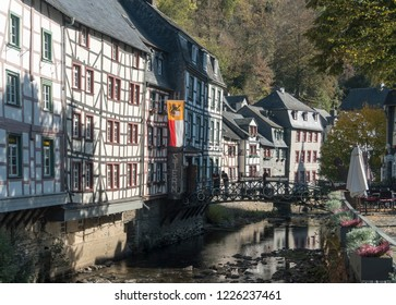 MONSCHAU, AACHEN, GERMANY, OCTOBER 2018 - Picturesque timber framed houses along the Rur River in the historic center of Monschau, Aachen, Germany