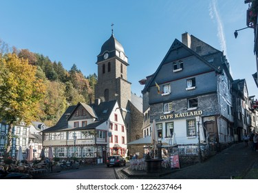 MONSCHAU, AACHEN, GERMANY, OCTOBER 2018 - Picturesque buildings and church in the market square in the historic center of Monschau, Aachen, Germany