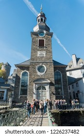 MONSCHAU, AACHEN, GERMANY, OCTOBER 2018 - Evangelist church with a group of tourists outside in the historic center of Monschau, Aachen, Germany