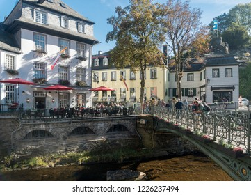 MONSCHAU, AACHEN, GERMANY, OCTOBER 2018 - Picturesque buildings and bridge along the Rur River in the historic center of Monschau, Aachen, Germany