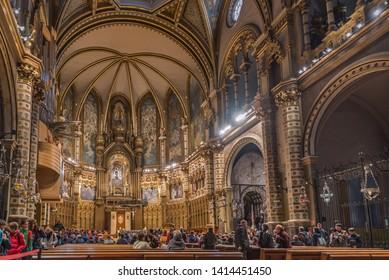 MONSERRAT, SPAIN - FEBRUARY 20, 2019: Interior of the Basilica of the Montserrat Monastery in the abbey of Santa Maria de Montserrat