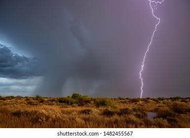 Monsoon Lightning And Faint Rainbow