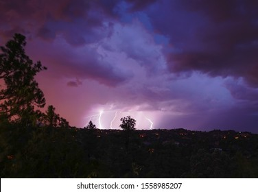 A monsoon lightning storm hits Arizona right after sunset, and accents the dramatic sky's colors.