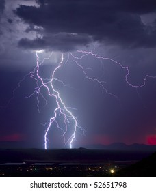 Monsoon storm with a hint of a fading red sunset