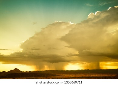 A monsoon storm over the desert of Arizona during sunset.