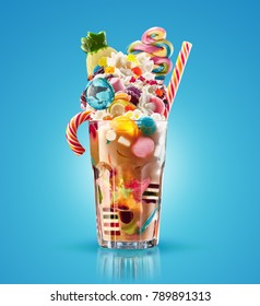 Monster shake, freak caramel shake isolated. Colourful, festive milk shake cocktail with sweets, jelly. Colored caramel milkshake array of different childs sweets and treats in glass on blue