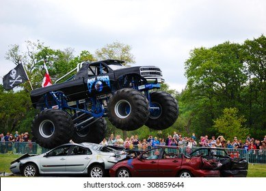Monster Truck Challenge at Truckmania, Beaulieu, England - May 24, 2015: The Grim Reaper jumping cars at Truckmania