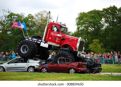 Monster Truck Challenge at Truckmania, Beaulieu, England - May 24, 2015: The Big Pete jumping cars at Truckmania