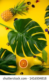 Monstera leaf background with fruits