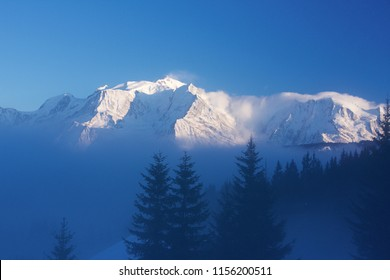 The Mont Blanc (4810m), the highest summit of Europe, emerging from the winter mist. Haute Savoie, Combloux, France.