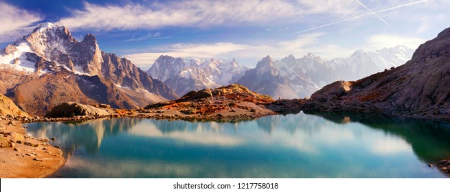 Mont Blanc Chamonix France autumn - picturesque lakes are fantastically beautiful after the first frost against the background of the steep peaks of the Alps with glaciers and rocks
