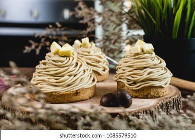 Mont Blanc Dessert or Chestnut Cream cake a dessert filled mostly with whipped cream. set on wooden table