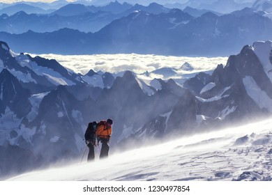 MONT BLANC, FRANCE - AUGUST 11, 2018: Mountaineers climbing in Chamonix, France. Mont Blanc is the highest mountain in Alps.