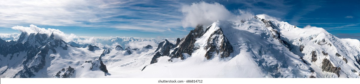 Mont Blanc is the highest mountain in the Alps and the highest in Europe. Beautiful panorama of European Alps in sunny day. Haute-Savoie, France - Shutterstock ID 686814712