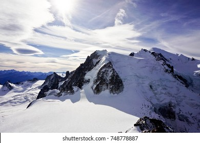 Mont blanc - the highest mountain in Europe (4810 meters) .White clouds and blue sky. Sunny weather. A view of the whole mountain.