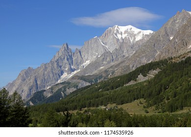Mont Blanc massif and blue sky. Val Ferret in Courmayeur