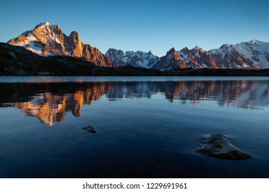 The Mont Blanc massif reflected in Lac de Chesery during sunset. Chamonix, France. Shallow D.O.F.