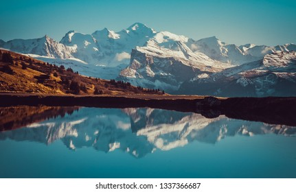 Mont Blanc massif reflected in lake - Mirror Effect