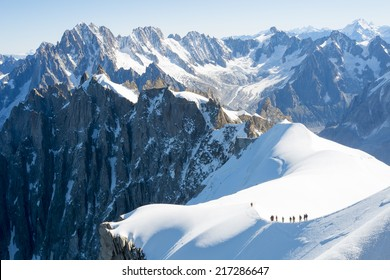 Mont Blanc mountaneers walking on snowy ridge. The mountain is the highest in the alps and the European Union.