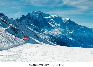 Mont Blanc in winter as viewed from a ski slope n the ski resort of Le Tour ion the French Alps. The piste is empty. Nobody