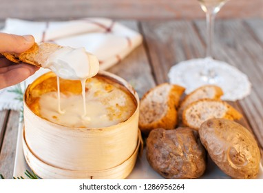 Mont d'or cheese. Traditional french  recipe - La boîte chaude. Delicious French Cheese. Mont-d'Or chaud.